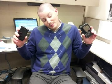 IT Recruiter Ryan holding up his iPhone and his Blackberry