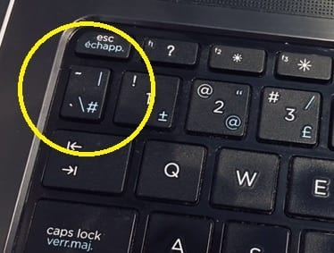 The tilde key on the keyboard